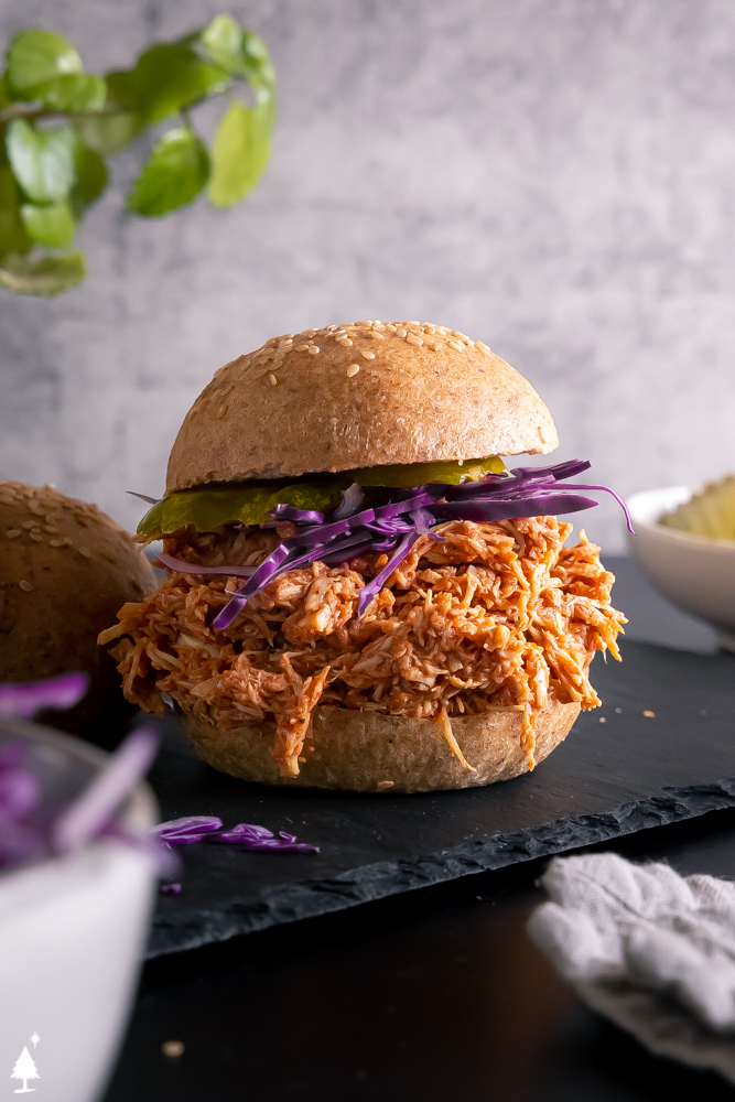 Keto pulled chicken Mexican placed in a bun