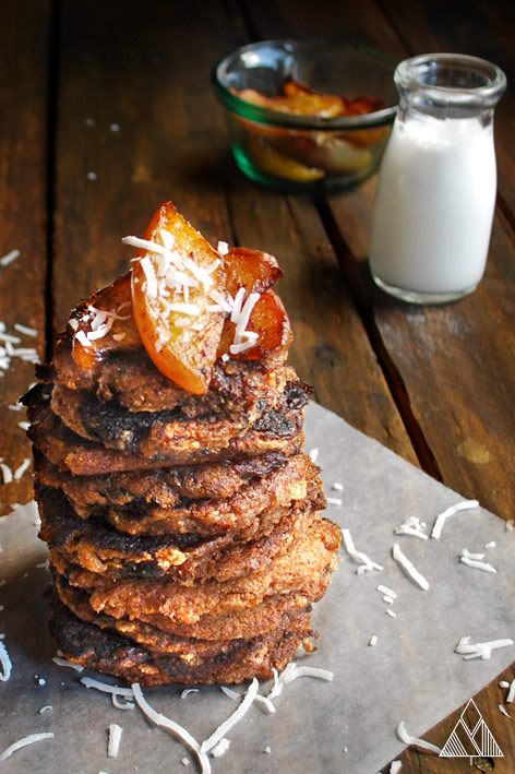 Coconut flour pancakes in a parchment paper with milk and other ingredient on the side