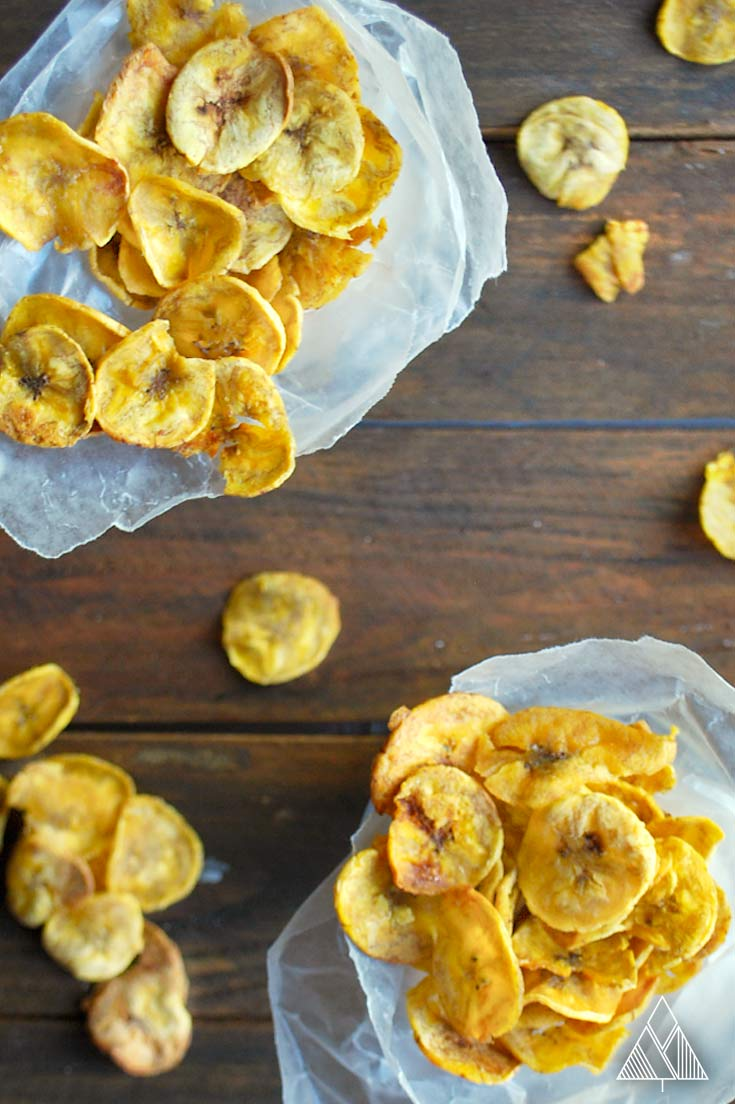2 groups of baked plantain chips in a parchment paper