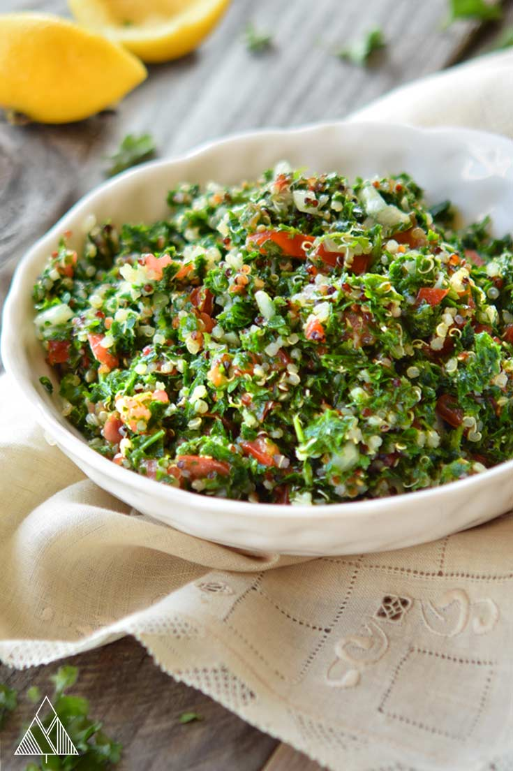 Bowl of tabouleh salad recipe on a napkin with lemons in background