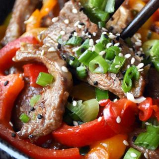 bowl of hunan beef with chopsticks
