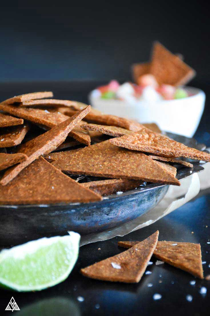 Low carb tortilla chips in a small plate with ingredients on the side