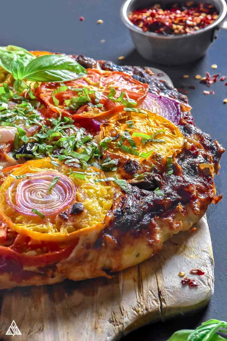 side view of a meatza on a cutting board