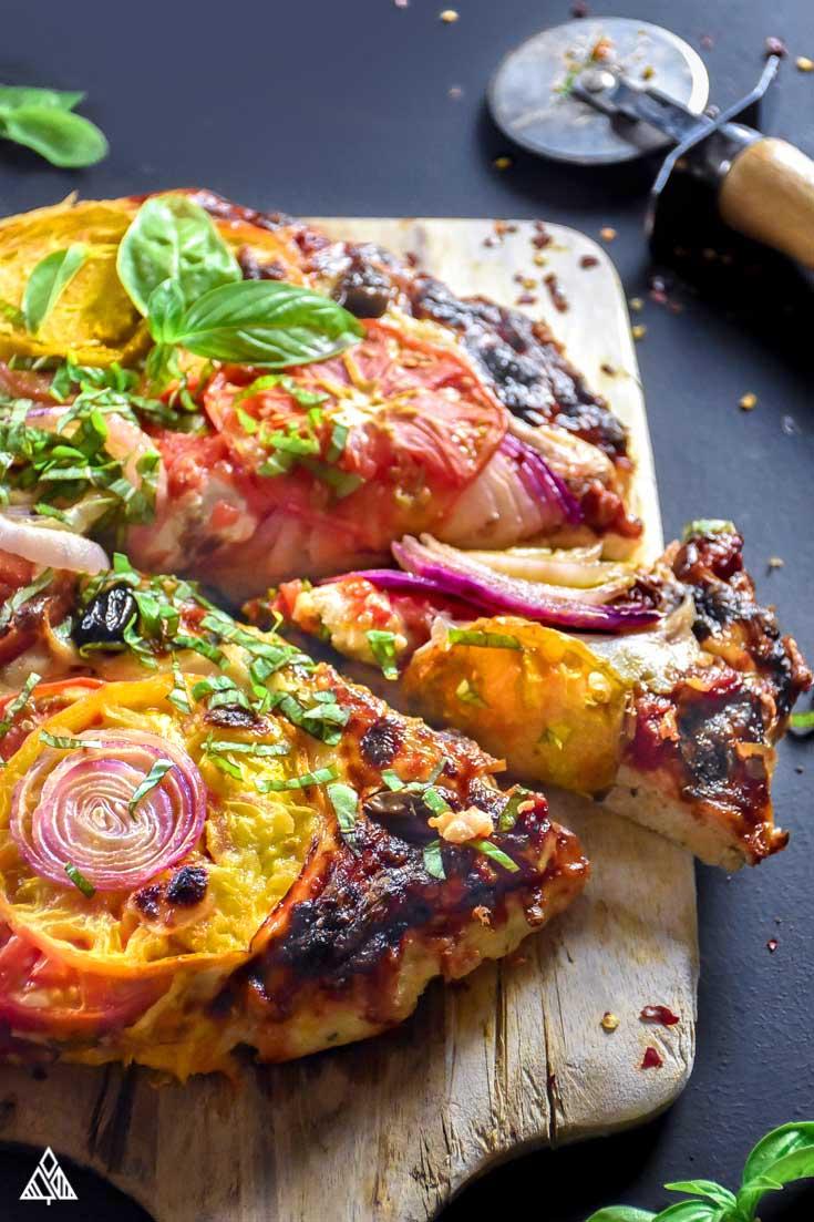 sliced piece of meatza on a cutting board