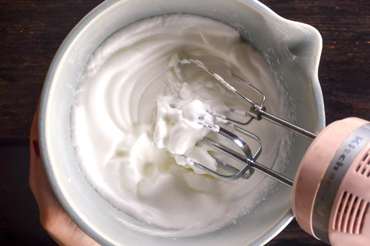 Beating the egg whites and other ingredients together