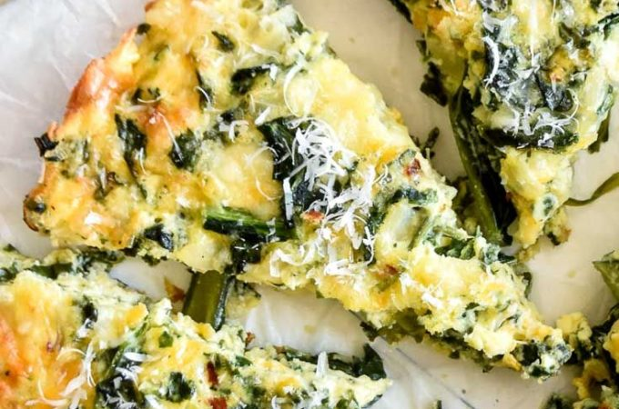 Don't let the title fool you, crustless spinach quiche is every bit as decedent and delicious as it's carb filled predecessor—only without the crust there's more room for those creamy, cheesy low carb foods we love! #lowcarb #keto #glutenfree #grainfree #healthy #recipe #weightwatchers #oven #baked #dinners #brunch #breakfast #onions #redpeppers #mozzarella #vegetables #vegetableoil #heavycream #freshspinach #eggwhites