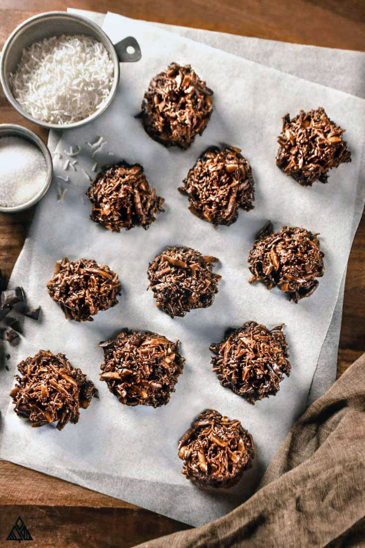 Low carb no bake cookies lined in a white parchment paper with ingredients on the side
