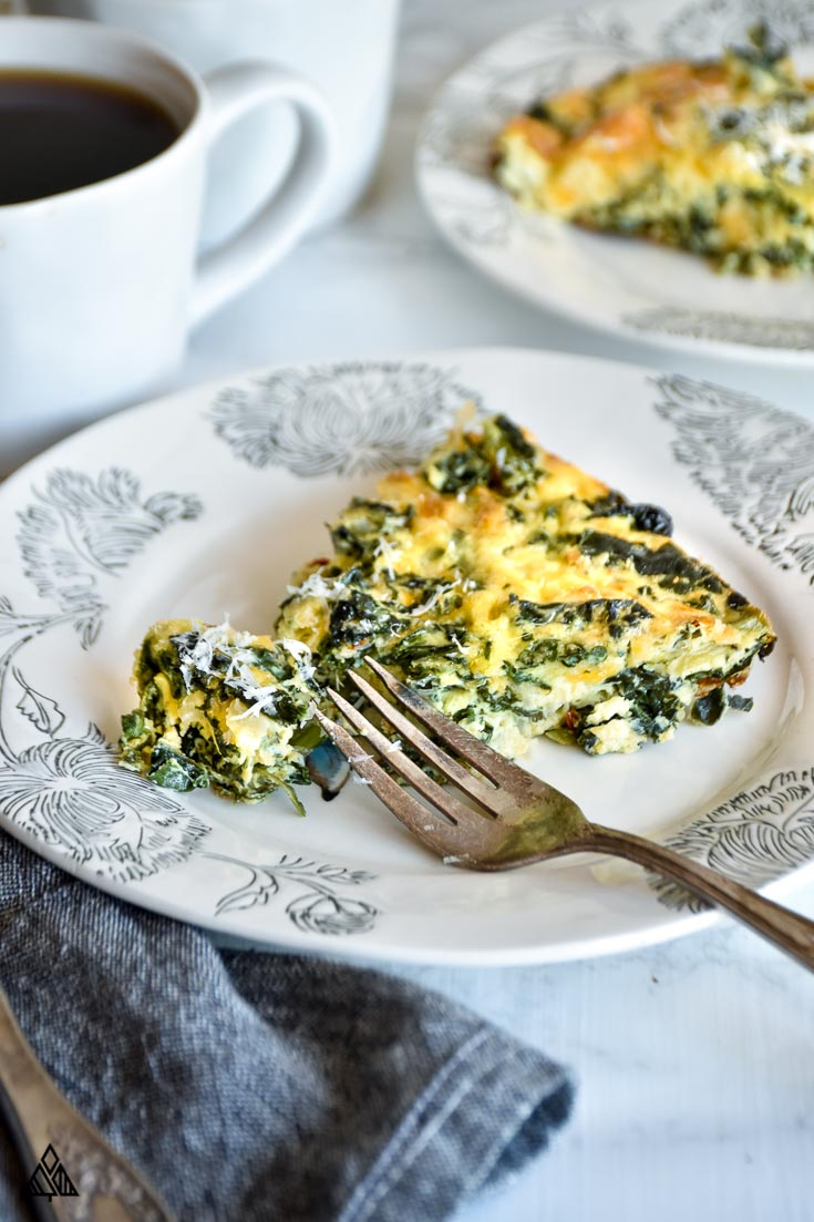 sliced of Crustless Spinach Quiche with parmesan cheese