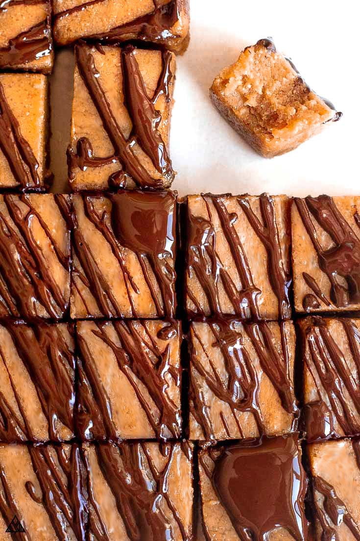 Low carb peanut butter fudge, sliced with a bite taken out of it