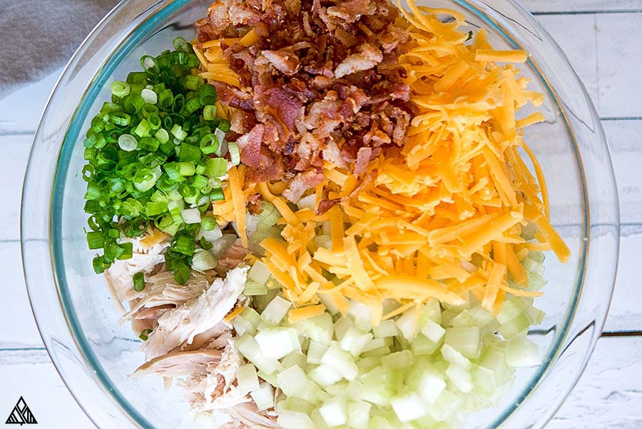 Ingredients for rotisserie chicken salad in a bowl