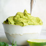 Avocado sauce in a white small bowl