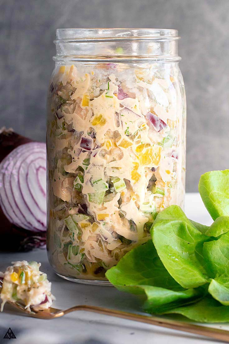 Chicken salad placed into a jar