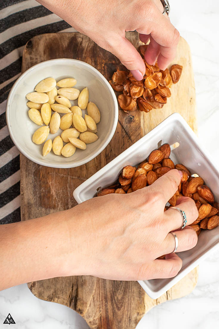 Taking away the skin of the almonds
