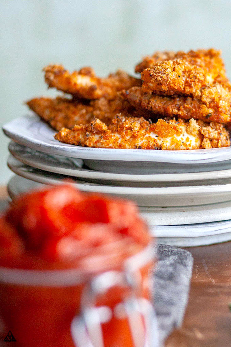 Keto fried chicken in a plate with ketchup on the side