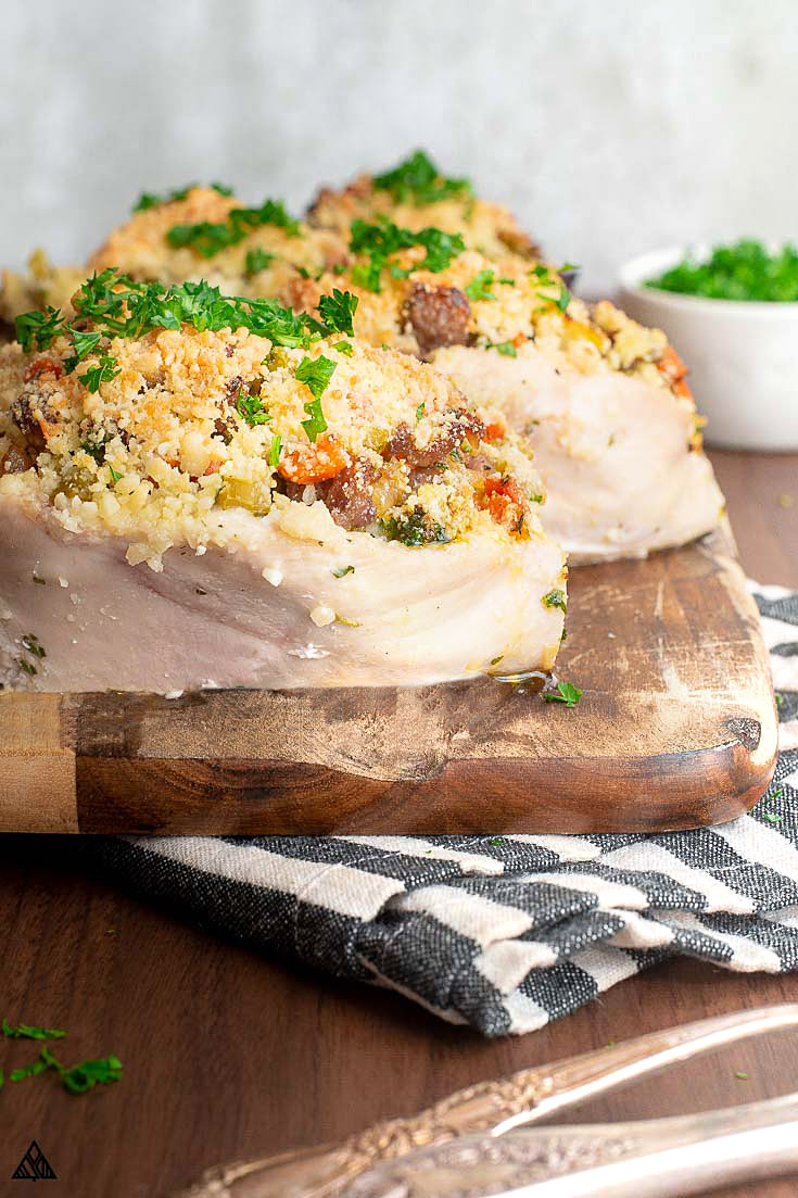 Chicken breast with stuffing on a chopping board
