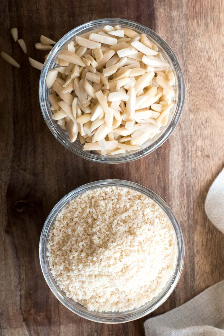 a bowl of blanched almonds and a bowl of almond flour