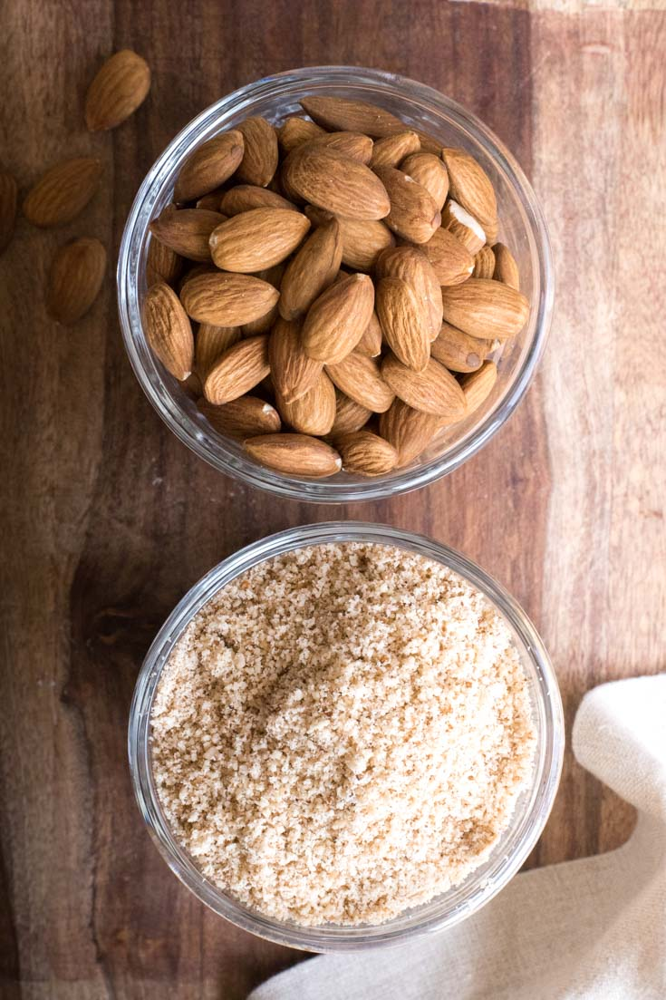A bowl of almonds and a bowl of almond meal