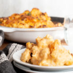 Cheesey cauliflower in a plate and in a pan