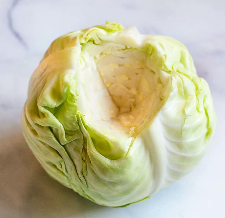 Whole cabbage in a white background