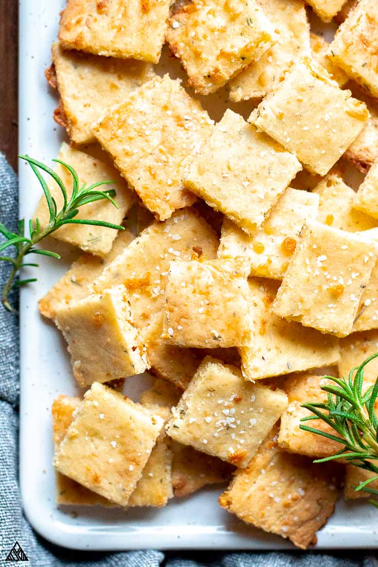 Keto crackers in a plate with fresh rosemary