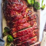 Sliced low carb meatloaf on a chopping board
