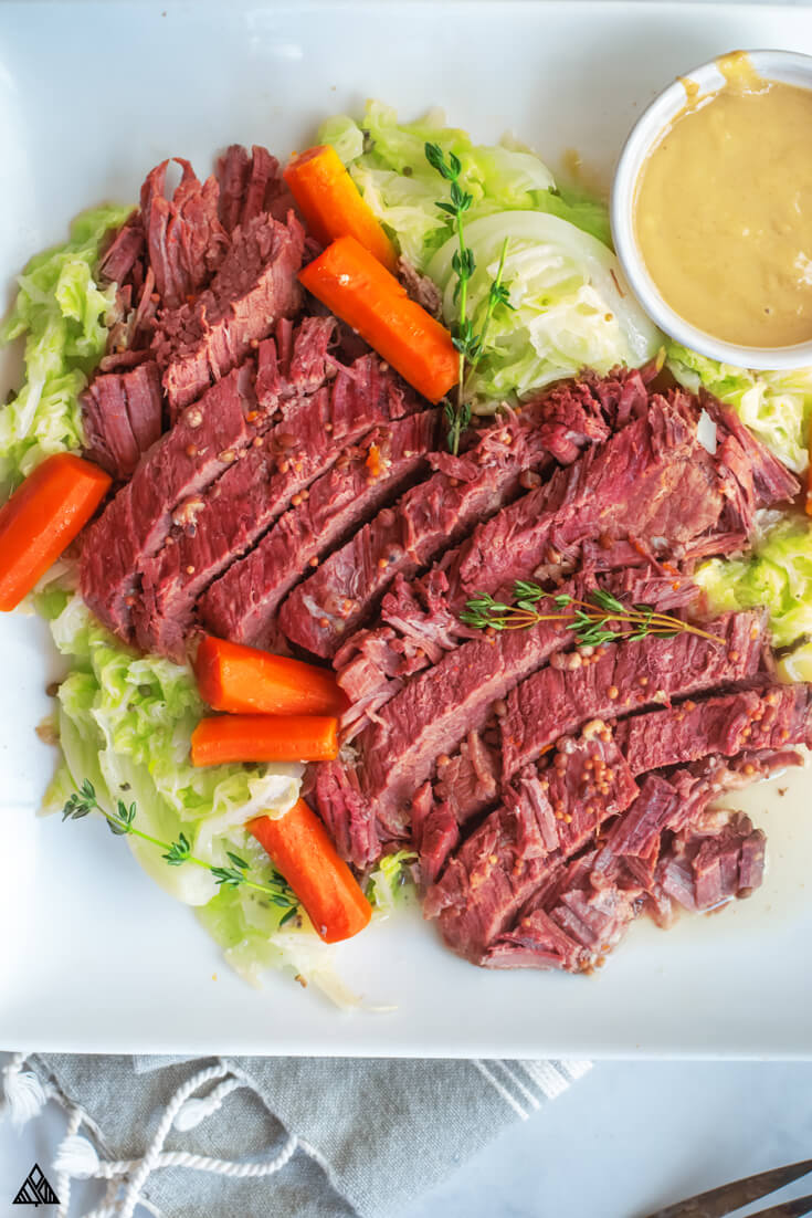Closer top view of instant pot corned beef in a white plate