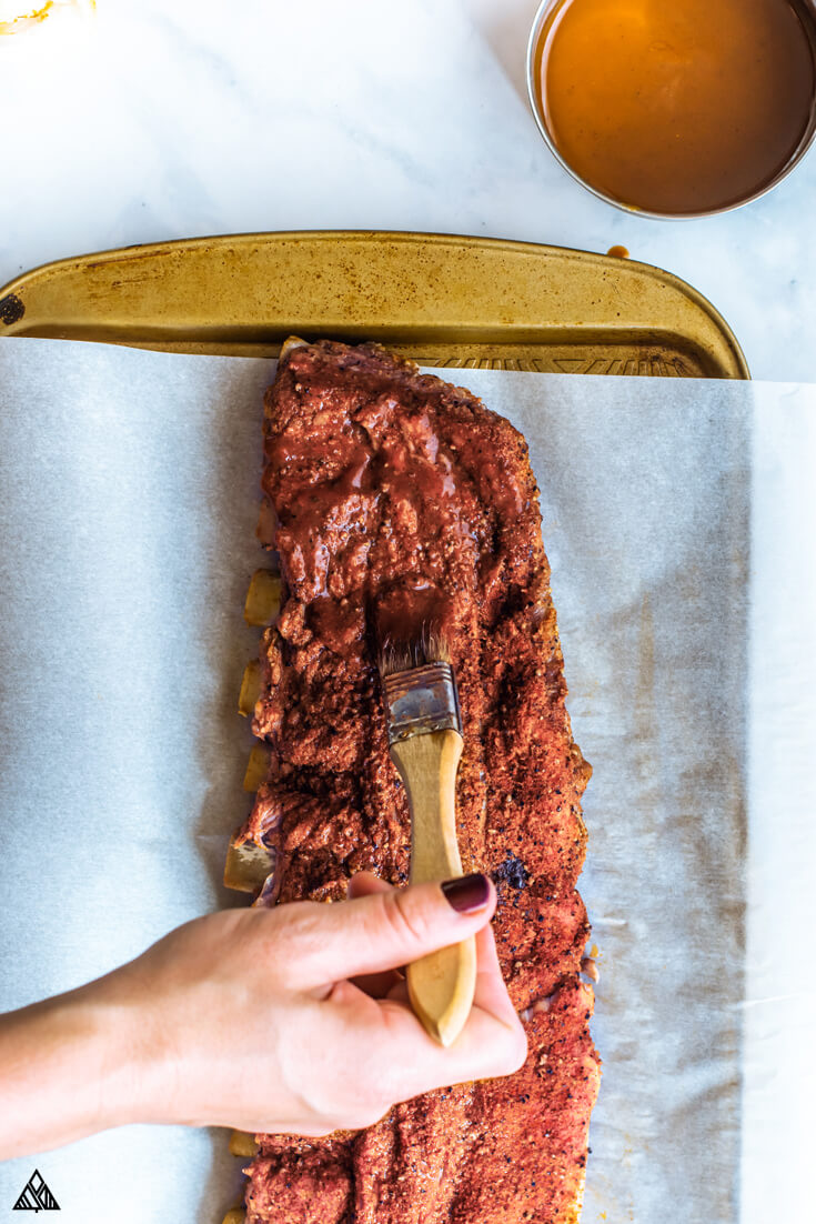 Brushing the ribs with low carb bbq sauce