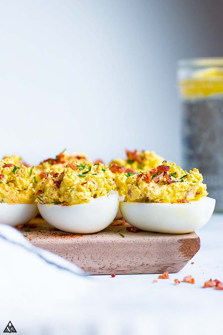 Keto deviled eggs on a cutting board