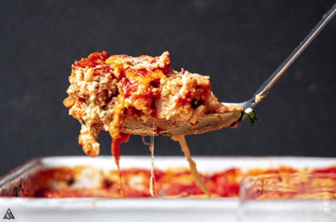 Slice of cabbage lasagna in a spoon