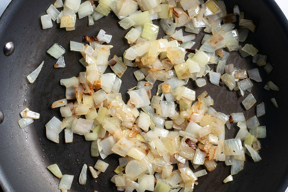 Sauted onions in a pan