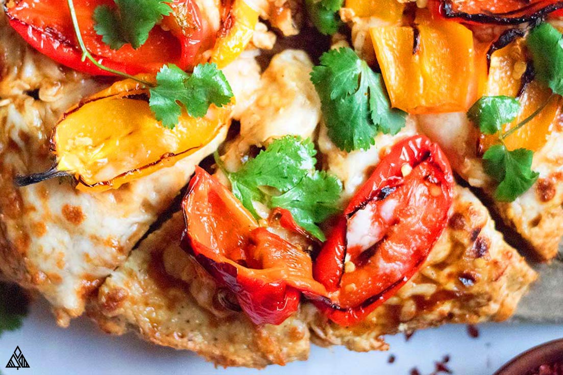 sliced chicken crust pizza with toppings