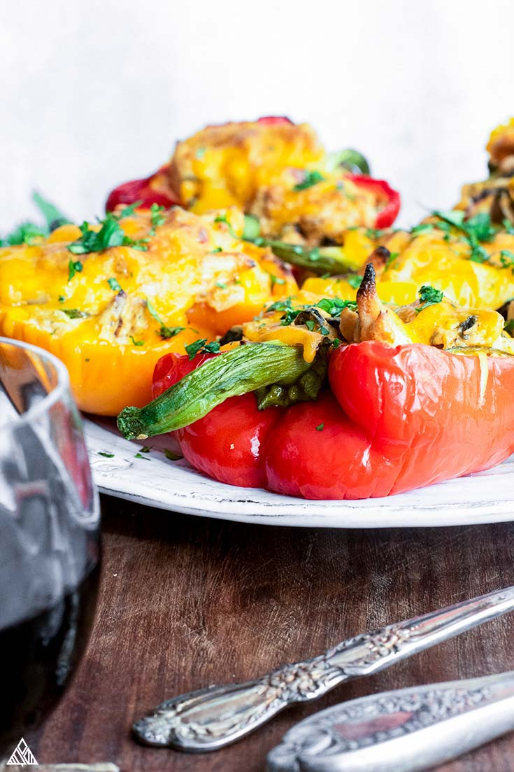 Side view of chicken stuffed peppers on a plate