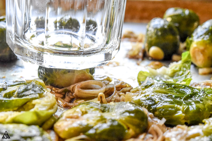Smashing the brussel sprouts using a glass