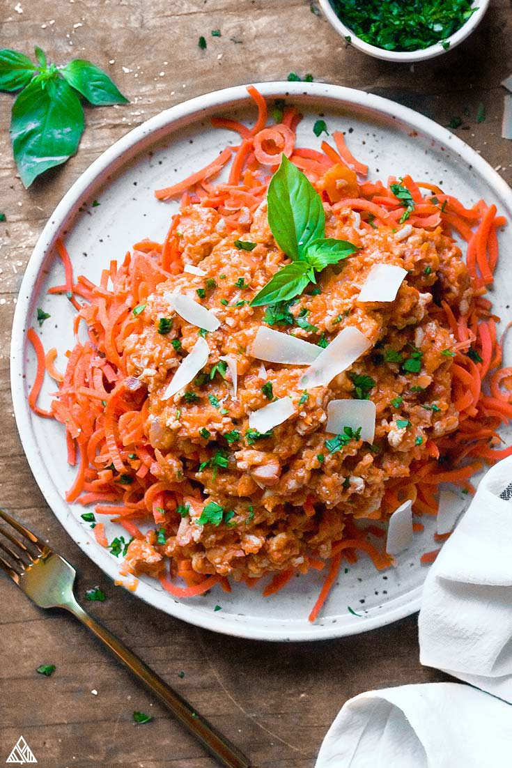 Top view of chicken bolognese in a plate