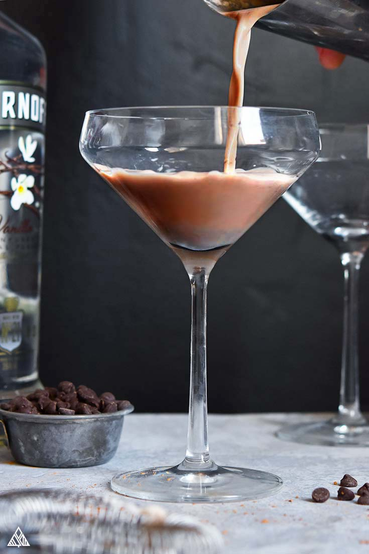 Pouring the chocolate milk into a wine glass