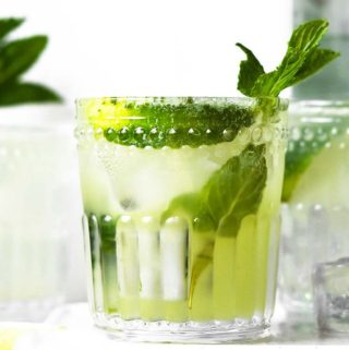 Keto mojito in a glass with fresh mint leaves