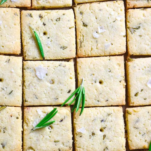 Top view of sliced low carb crackers with sprinkled rosemary
