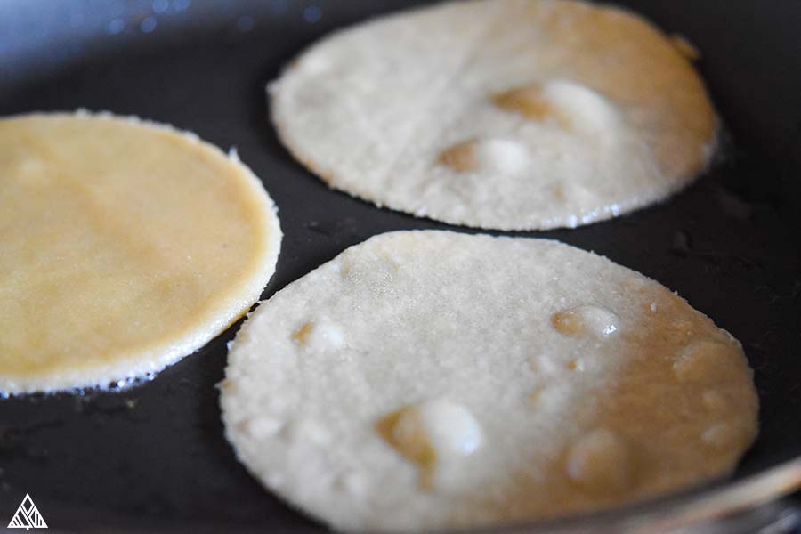 Cooking the low carb tortillas in a pan