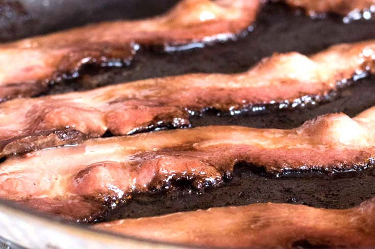 Cooking the bacon strips
