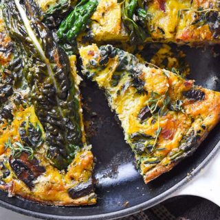 Top view of sliced paleo frittata in a skillet pan