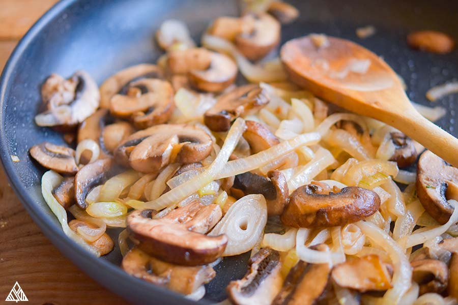 Sauteing the mushrooms and all the other ingredients in a pan