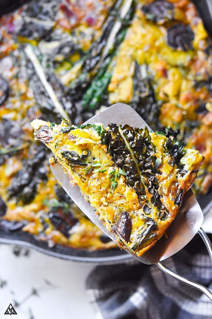 A slice of paleo frittata in a laddle