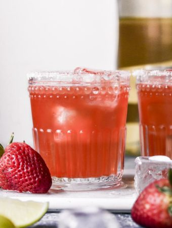 glasses of low carb strawberry margarita with strawberries on the side