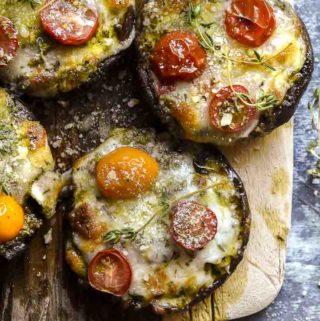 Portobello mushroom pizza on a cutting board