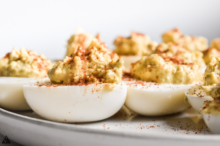 Closer look of classic deviled eggs in a plate