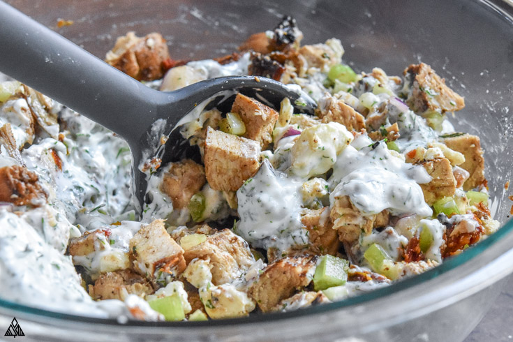 Mixing the ingredients for greek yogurt chicken salad