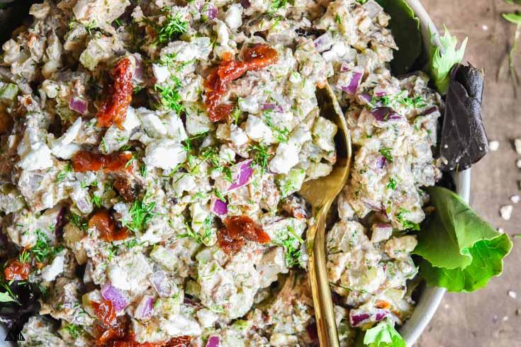 Greek yogurt chicken salad in a bowl with spoon