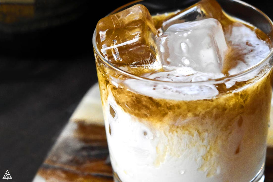 Closer look of keto white russian in a glass full of ice