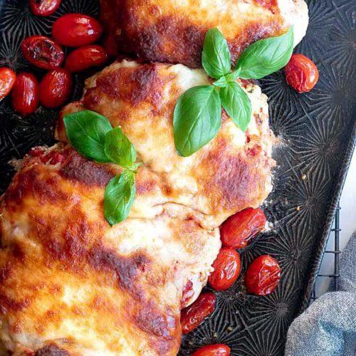Lasagna stuffed chicken in a baking sheet