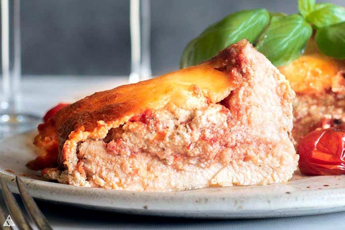 Closer look of a sliced lasagna stuffed chicken